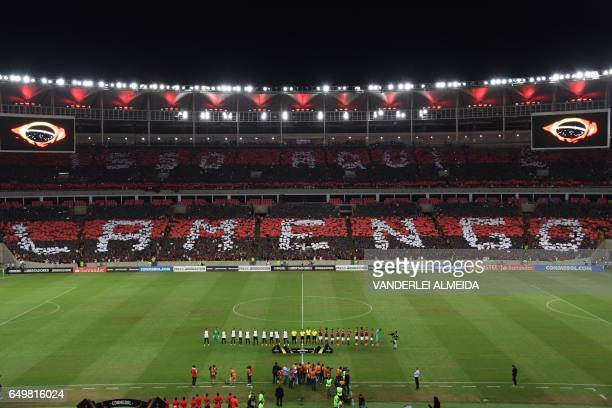 Brazil's Flamengo fans display placards to form words of support for their team before the start of the Copa Libertadores football match against...