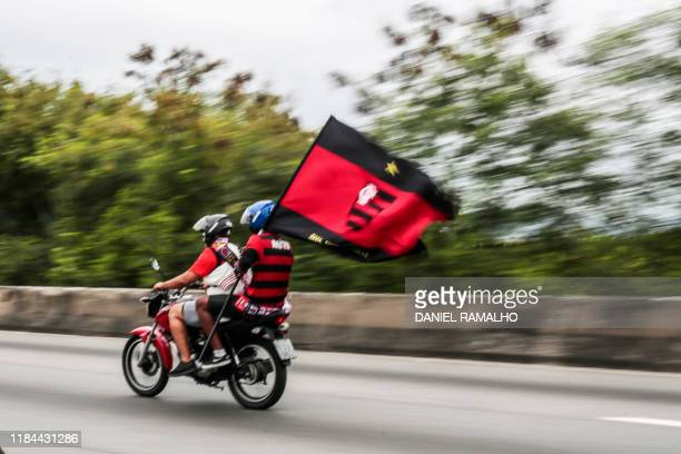 Brazil's Flamengo fans rides following the team bus before the celebration parade after their Libertadores Final football match victory against...