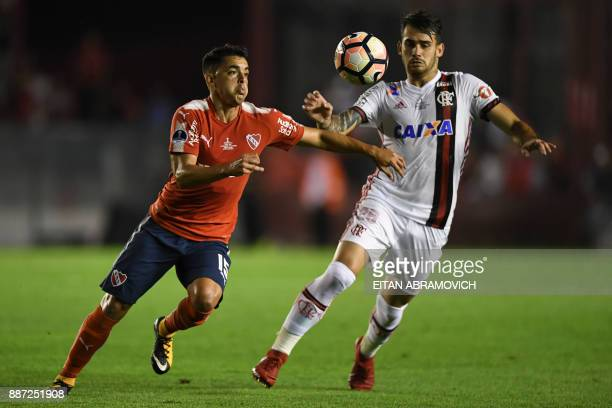 Brazil's Flamengo forward Felipe Vizeu vies for the ball with Argentina's Independiente midfielder Diego Rodriguez during the Copa Sudamericana first...