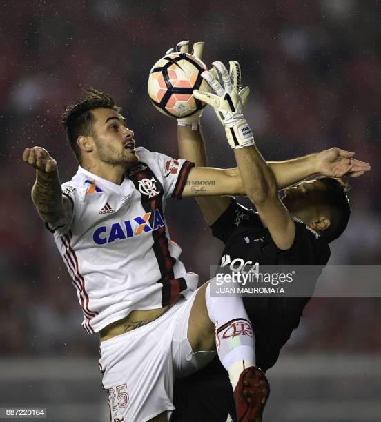 Brazil's Flamengo forward Felipe Vizeu vies for the ball with Argentina's Independiente goalkeeper Martin Campana during their Copa Sudamericana...