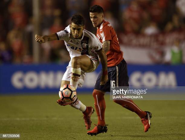 Brazil's Flamengo forward Lucas Paqueta vies for the ball with Argentina's Independiente defender Fabricio Bustos during the Copa Sudamericana first...