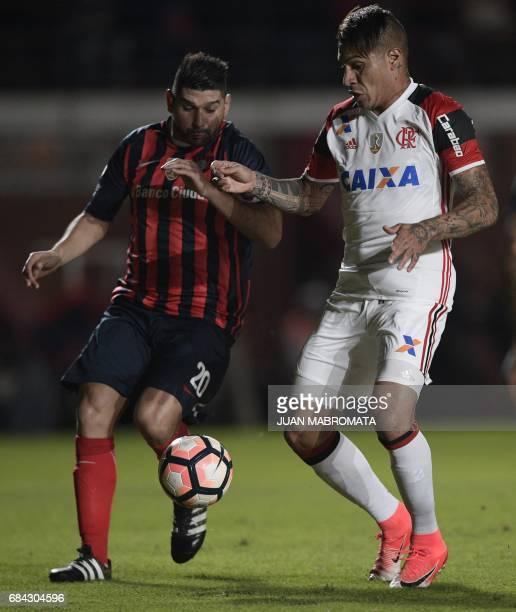 Brazil's Flamengo forward Paolo Guerrero vies for the ball with Argentina's San Lorenzo defender Nestor Ortigoza during their Copa Libertadores 2017...