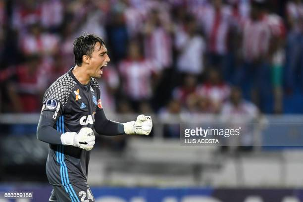 Brazil's Flamengo goalkeeper Cesar Dutra reacts after stopping a penalty shot to Colombia's Junior during the Copa Sudamericana semifinal second leg...