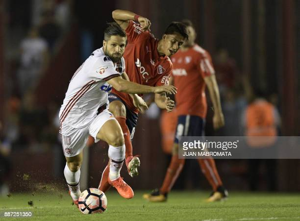 Brazil's Flamengo midfielder Diego vies for the ball with Argentina's Independiente midfielder Maximiliano Meza during their Copa Sudamericana first...