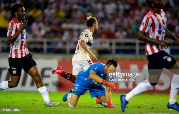 Brazil's Flamengo midfielder Everton Ribeiro celebrates after scoring a goal against Colombia's Junior de Barranquilla during their Copa Libertadores...