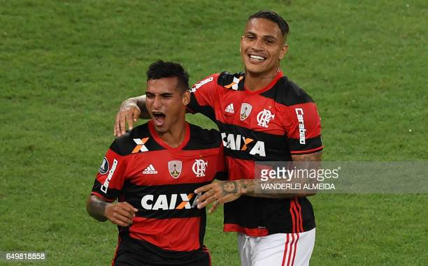 Brazil's Flamengo Miguel Trauco celebrates with teammate Paolo Guerrero after scoring a second goal against Argentina's San Lorenzo during their...