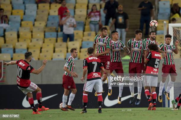 Brazil's Flamengo player Diego shoots to score against Brazil's Fluminense during the 2017 Sudamericana Cup football match at Maracana stadium in Rio...