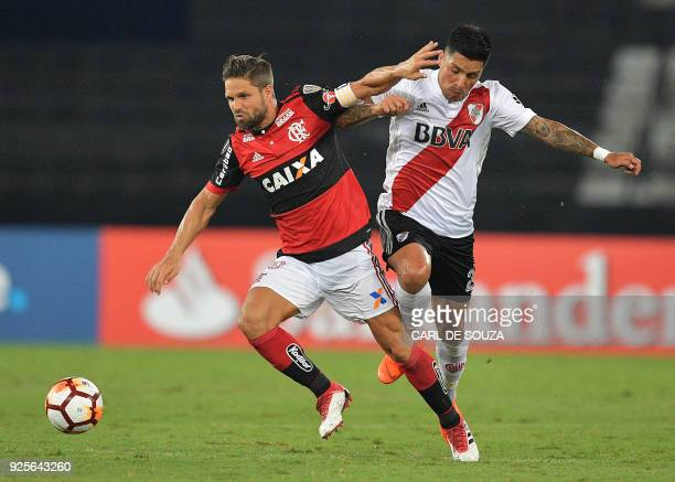 Brazil's Flamengo player Diego vies for the ball with Argentina's River Plate Enzo Perez during their group stage Copa Libertadores football match at...