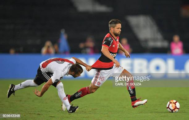 Brazil's Flamengo player Diego vies for the ball with Argentina's River Plate Marcelo Saracchi during their group stage Copa Libertadores football...