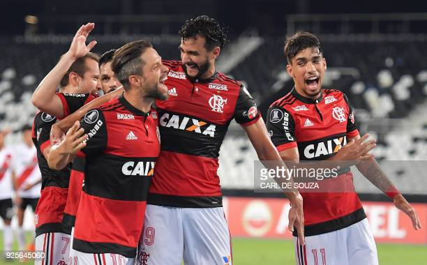 Brazil's Flamengo player Henrique Dourado celebrates after scoring against Argentina's River Plate during their group stage Copa Libertadores...