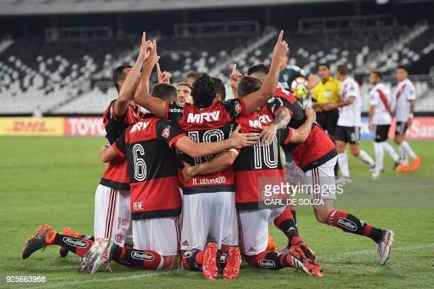 Brazil's Flamengo player Henrique Dourado celebrates with team mates after scoring their first goal against Argentina's River Plate during their...