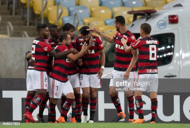 Brazil's Flamengo player Henrique Dourado celebrates with teammates after scoring a goal against Colombia's Independiente Santa Fe team during the...