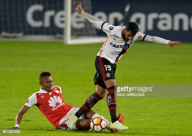 Brazil's Flamengo player Henrique Dourado vies for the ball with Colombia's Independiente Santa Fe player William Tesillo during their Copa...