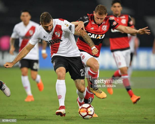 Brazil's Flamengo player Juan vies for the ball with Argentina's River Plate Lucas Pratto during their group stage Libertadores football match at...