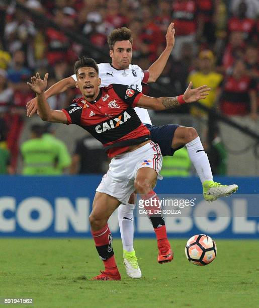 Brazil's Flamengo player Lucas Paqueta vies for the ball with Argentina's Independiente player Nicolas Tagliafico during the 2017 Sudamericana Cup...