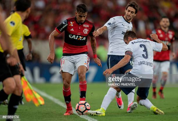 Brazil's Flamengo player Lucas Paqueta vies for the ball with Argentina's Independiente player Nicolas Tagliafico during their 2017 Sudamericana Cup...