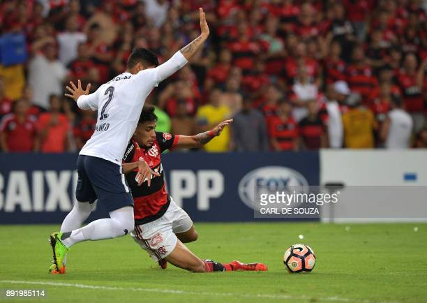 Brazil's Flamengo player Lucas Paqueta vies for the ball with Argentina's Independiente player Fernando Amorebieta during their 2017 Sudamericana Cup...