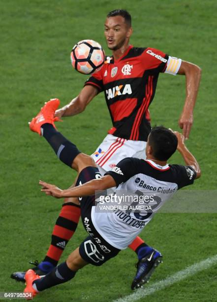 Brazil's Flamengo player Rever vies for the ball with Argentina's San Lorenzo Lautaro Montoya during their Libertadores Cup football match at the...