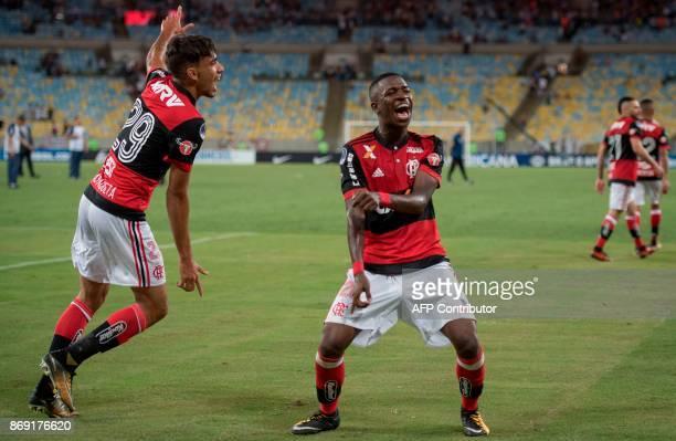 Brazil's Flamengo player Vinicius Jr and Lucas Paqueta celebrate qualifying for the 2017 Sudamericana Cup semifinals at Maracana stadium in Rio de...