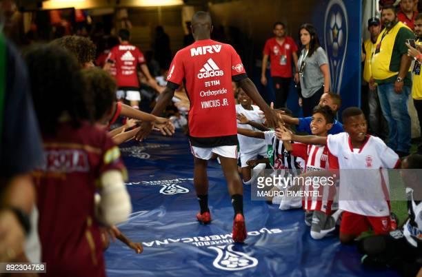 Brazil's Flamengo player Vinicius Jr greets children before the Copa Sudamericana football final against Argentina's Independiente at the Maracana...