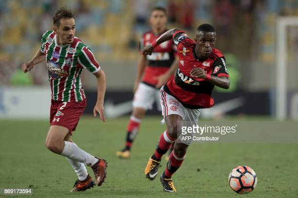 Brazil's Flamengo player Vinicius Jr vies for the ball with Brazil's Fluminense player Lucas during the 2017 Sudamericana Cup football match at...