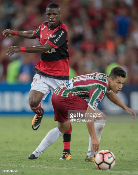 Brazil's Flamengo player Vinicius Jr vies for the ball with Brazil's Fluminense player Marlon during their 2017 Sudamericana Cup football match at...