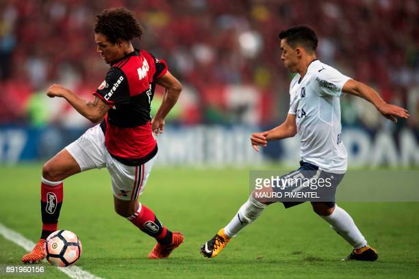 Brazil's Flamengo player Willian Arao vies for the ball with Argentina's Independiente player Diego Rodriguez during their 2017 Sudamericana Cup...