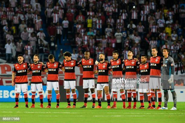 Brazil's Flamengo players hold a minute of silence in honour of the victims and survivors of Lamia flight 2933 two days after the first anniversary...