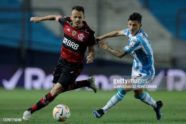 Brazil's Flamengo Rene and Argentina's Racing Club Hector Fertoli vie for the ball during their closed-door Copa Libertadores round before the...