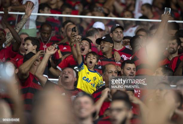 Brazil's Flamengo supporters celebrate the victory against Ecuador's Emelec team during the Copa Libertadores 2018 football match between Brazil's...