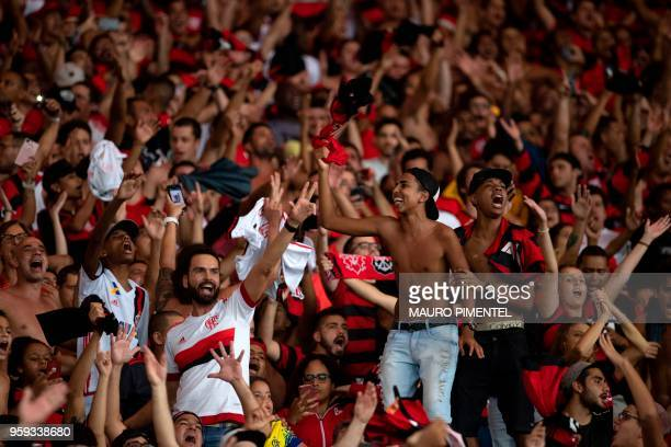 Brazil's Flamengo supporters celebrate their team won a Copa Libertadores 2018 football match against Ecuador's Emelec at Maracana Stadium in Rio de...