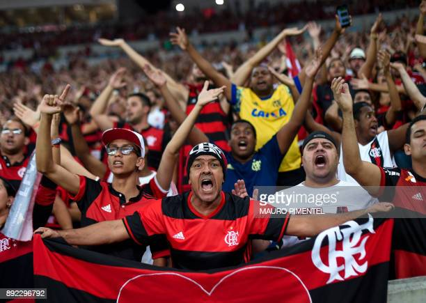 Brazil's Flamengo supporters cheer for their team before the Copa Sudamericana football final against Argentina's Independiente at the Maracana...
