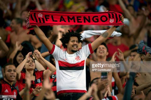 Brazil's Flamengo supporters cheer for their team during the 2017 Copa Sudamericana football match against Brazil's Fluminense at Maracana stadium in...