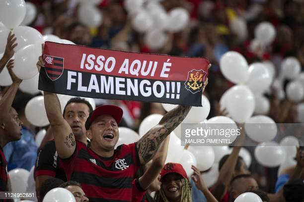 Brazil's Flamengo supporters cheer in honor of 10 Flamengo players who died in a fire that engulfed their dormitories at Flamengo headquarters before...