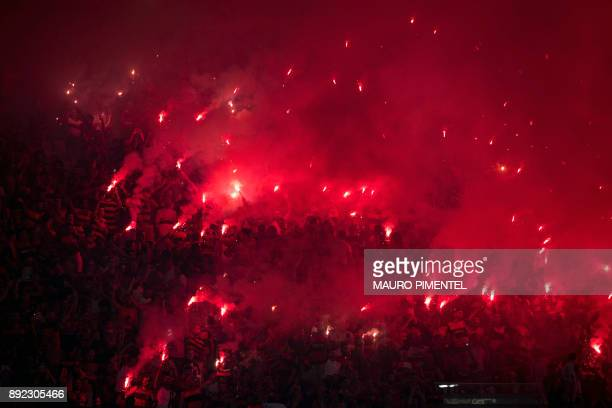Brazil's Flamengo supporters light flares before the Copa Sudamericana football final against Argentina's Independiente at the Maracana stadium in...