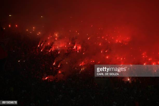 Brazil's Flamengo supporters light flares during the Copa Sudamericana football final against Argentina's Independiente at the Maracana stadium in...