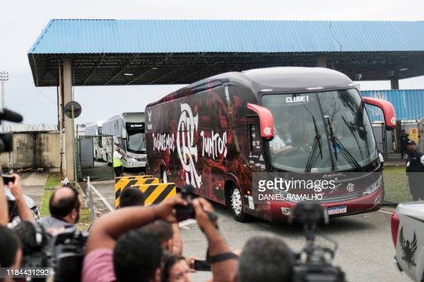 Brazil's Flamengo team bus leaves the Airport to meet their fans at a celebration parade after their Libertadores Final football match victory...