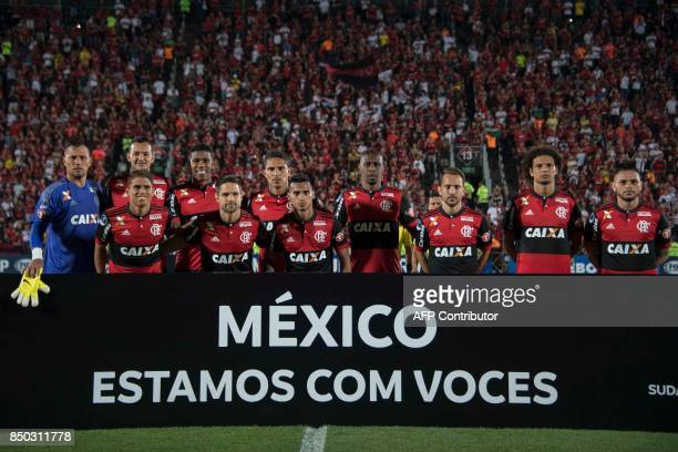 Brazil's Flamengo team members pose with a banner that reads 'Mexico We Are With You' before their 2017 Copa Sudamericana football match against...