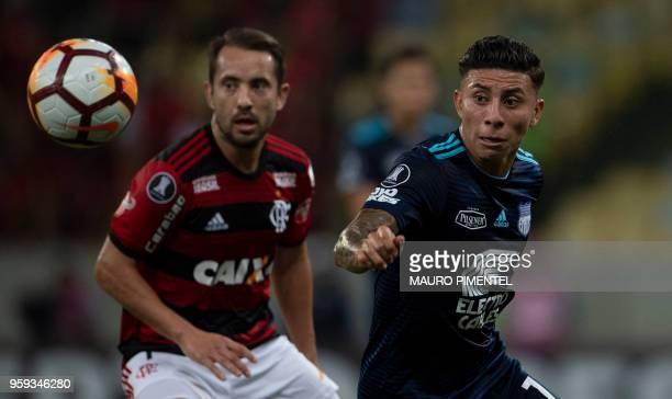 Brazil's Flamengo team player Everton Ribeiro vies for the ball with Ecuador's Emelec player Jefferson Antonio during the Copa Libertadores 2018...