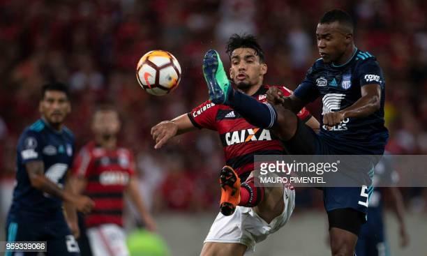 Brazil's Flamengo team player Lucas Paqueta vies for the ball with Ecuador's Emelec player Dixon Arroyo during the Copa Libertadores 2018 football...