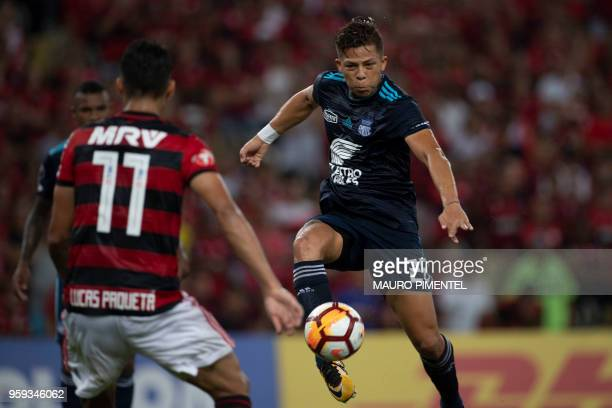 Brazil's Flamengo team player Lucas Paqueta vies for the ball with Ecuador's Emelec player Marlon Mauricio Mejia during the Copa Libertadores 2018...