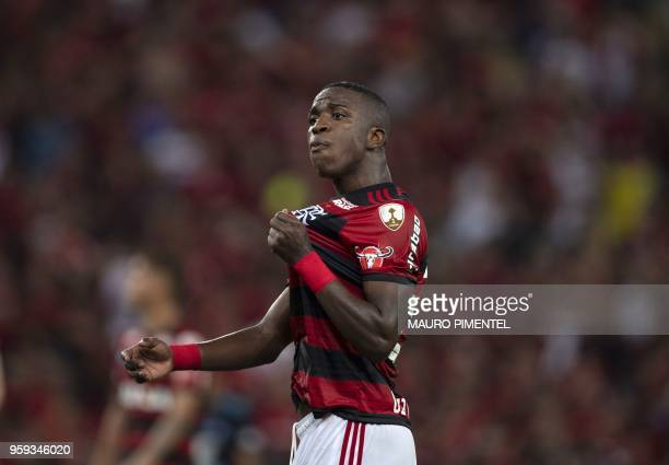 Brazil's Flamengo team player Vinicius Junior shouts calling for fans to cheer during the Copa Libertadores 2018 football match between Brazil's...
