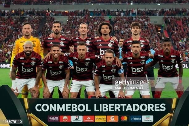Brazil's Flamengo team poses before a 2019 Copa Libertadores football match against Brazil's Internacional at the Maracana stadium in Rio de Janeiro...