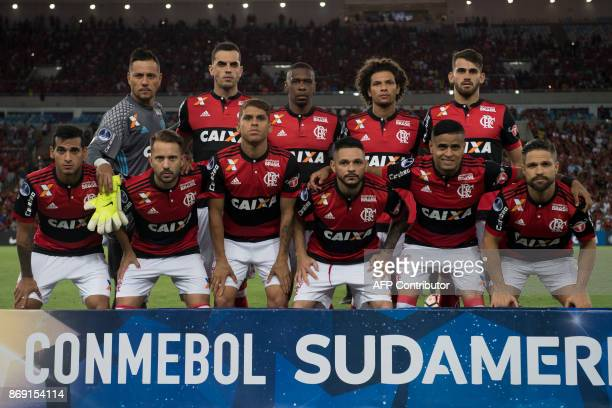 Brazil's Flamengo team poses for pictures before their 2017 Sudamericana Cup football match against Brazil's Fluminense at Maracana stadium in Rio de...