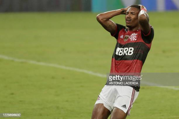 Brazil's Flamengo Vitinho reacts during the closed-door Copa Libertadores round before the quarterfinals football match against Argentina's Racing...