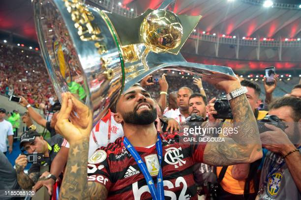 Brazil's Flamengo's Gabriel Barbosa aka Gabigol holds up the Brasileiro trophy at Maracana stadium, Rio de Janeiro on November 27, 2019. - This...