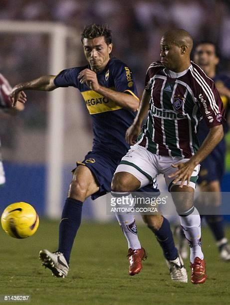 Brazil's Fluminense footballer Cicero Santos vies for the ball with Rafael Gonzalez of Argentina's Boca Juniors on June 4 2008 during their...