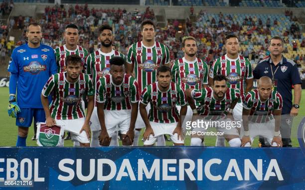 Brazil's Fluminense footballers pose for pictures before the 2017 Sudamericana Cup football match against Brazil's Flamengo at Maracana stadium in...