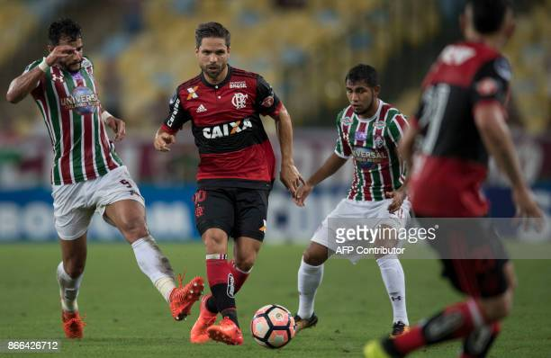 Brazil's Fluminense Henrique Dourado and Junior Sornoza vies for the ball with Brazil's Flamengo Diego during the 2017 Sudamericana Cup football...