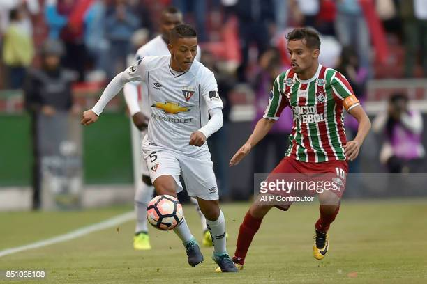 Brazil's Fluminense player Gustavo Scarpa vies for the ball with Ecuador's Liga de Quito player Jefferson Intriago during their 2017 Sudamericana Cup...